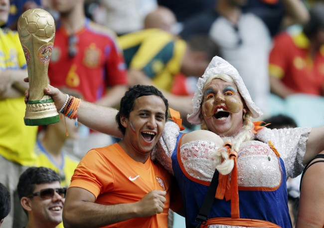 Dutch fans cheer before the group B World Cup soccer match between Spain and the Netherlands at the Arena Ponte Nova in Salvador, Brazil, Friday, June 13, 2014.