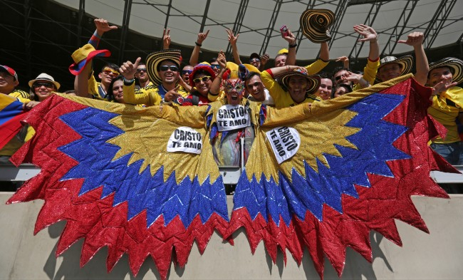 lombian supporters react before the start of the group C World Cup soccer match between Colombia and Greece at the Mineirao Stadium in Belo Horizonte, Brazil, Saturday, June 14, 2014. (AP Photo/Jon Super)