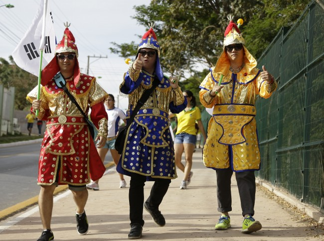A South Korean fans arrive to the Arena Pantanal before the group H World Cup soccer match between Russia and South Korea in Cuiaba, Brazil, Tuesday, June 17, 2014. (AP Photo/Thanassis Stavrakis)
