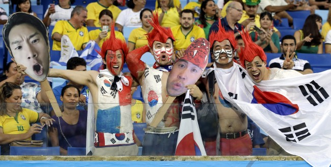 outh Korean fans react before the start of the group H World Cup soccer match between Russia and South Korea at the Arena Pantanal in Cuiaba, Brazil, Tuesday, June 17, 2014. (AP Photo/Lee Jin-man)