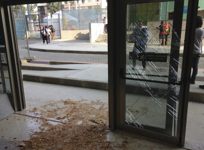 A door is damaged after Chile fans broke into the press center