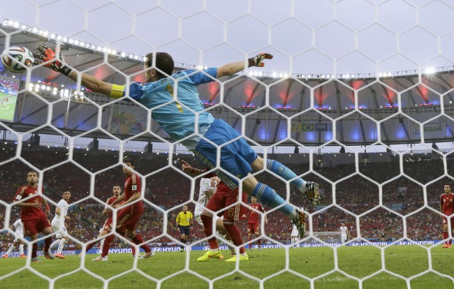 Spain's goalkeeper Iker Casillas fails to make a save as Chile's Charles Aranguiz scores his side's 2nd goal