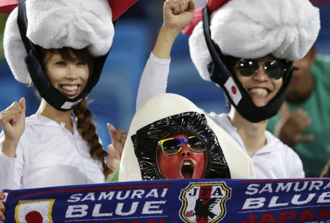 Japanese fans cheer before the start of the group C World Cup soccer match between Japan and Greece at the Arena das Dunas in Natal, Brazil, Thursday, June 19, 2014. (AP Photo/Petr David Josek)