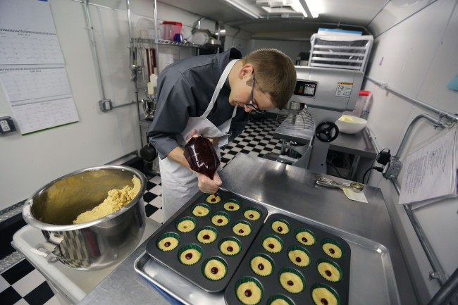 Chef Alex Tretter adds strawberry jam to cannabis-infused peanut butter and jelly cups before baking the