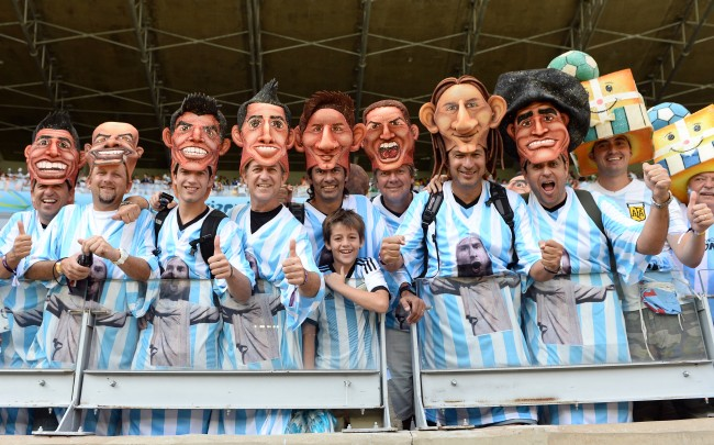 Argentinian fans pose with their national team player head wear before the group F World Cup soccer match between Argentina and Iran at the Mineirao Stadium in Belo Horizonte, Brazil, Saturday, June 21, 2014. (AP Photo/Martin Meissner)