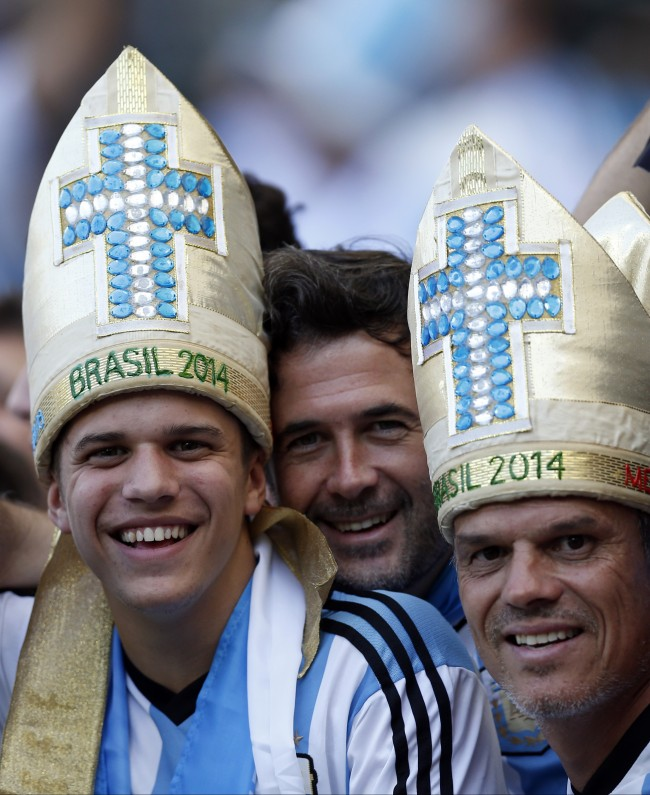 Argentina supporters smile before the start of the group F World Cup soccer match between Argentina and Iran at the Mineirao Stadium in Belo Horizonte, Brazil, Saturday, June 21, 2014. (AP Photo/Victor R. Caivano)
