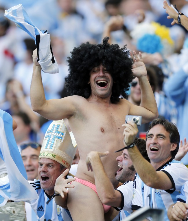 Argentine fans celebrate after the group F World Cup soccer match between Argentina and Iran at the Mineirao Stadium in Belo Horizonte, Brazil, Saturday, June 21, 2014. Argentina won the match 1-0. (AP Photo/Victor R. Caivano)