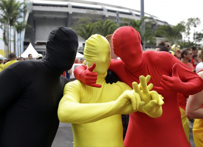 Belgian supporters pose outside the Maracana Stadium before the group H World Cup soccer match between Belgium and Russia in Rio de Janeiro, Brazil, Sunday, June 22, 2014. (AP Photo/Natacha Pisarenko)