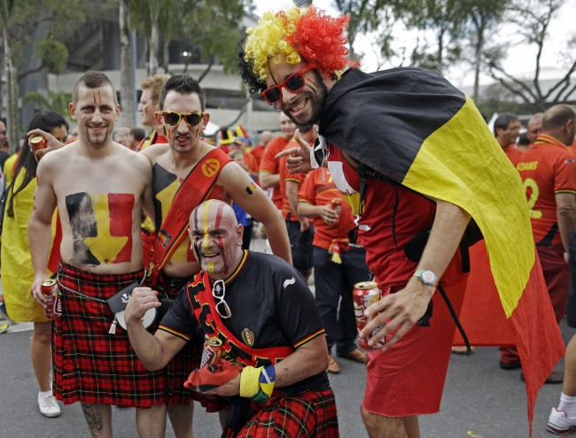 Belgian supporters pose outside Maracana Stadium before the group H World Cup soccer match between Belgium and Russia at the Maracana Stadium in Rio de Janeiro, Brazil, Sunday, June 22, 2014.