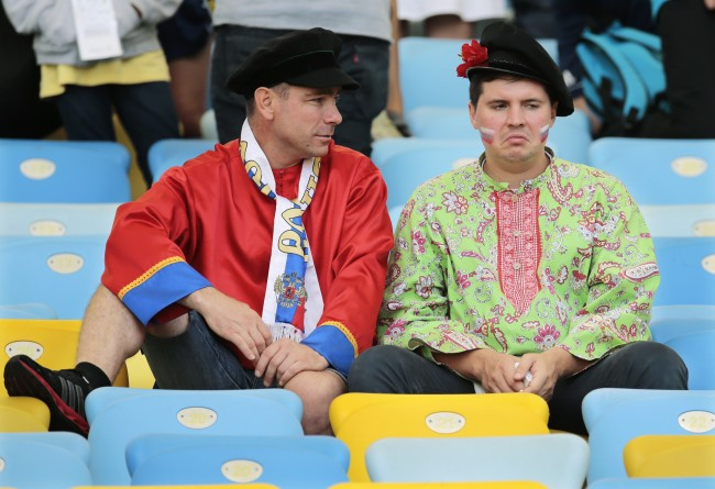 Russian supporters react as they sit in the stands after the group H World Cup soccer match between Belgium and Russia at the Maracana Stadium in Rio de Janeiro, Brazil, Sunday, June 22, 2014. Belgium won the match 1-0.