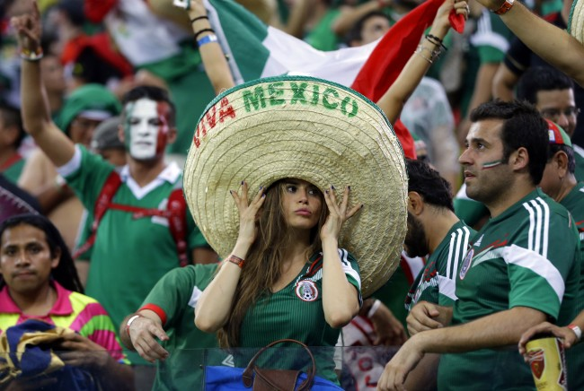 Mexico's fans celebrate after the group A World Cup soccer match between Croatia and Mexico at the Arena Pernambuco in Recife, Brazil, Monday, June 23, 2014. Mexico won 3-1. (AP Photo/Ricardo Mazalan)