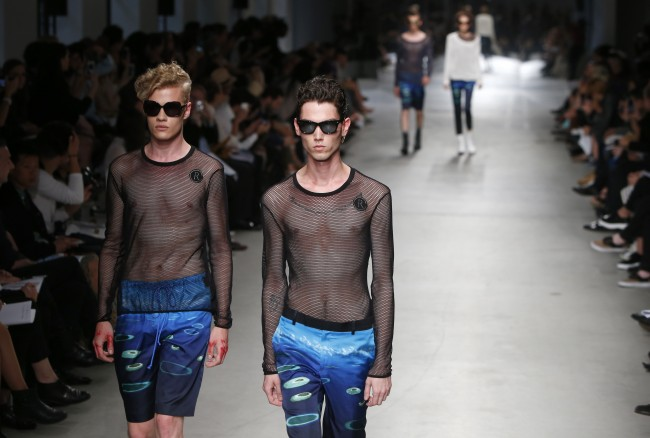 Models wear creations for Rynshu men's spring-summer 2015 fashion collection presented in Paris, France, Sunday, June 29, 2014. (AP Photo/Francois Mori)