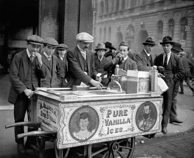 An Italian ice cream seller, Mr Allocca, and his patriotically decorated ice cream cart which displays images of King George V and Queen Mary, selling ice creams on the streets of London. Ref #: PA.3920272  Date: 03/01/1921