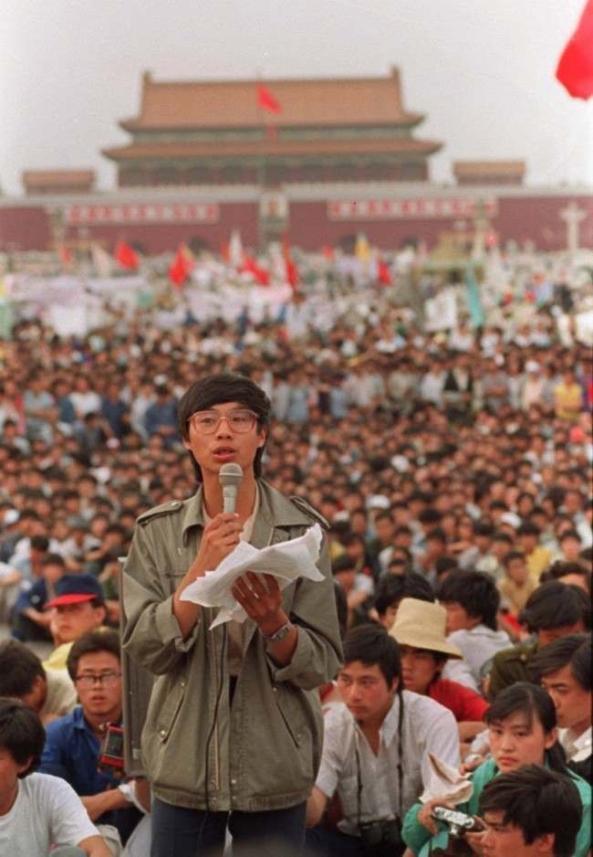 This is a May 27, 1989 photo of student leader Wang Dan in Tiananmen Square Beijing calling for a city wide march. (AP Photo/Mark Avery)