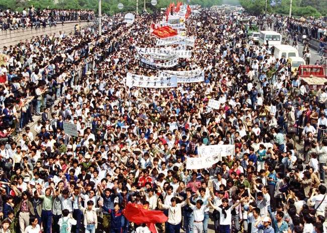 More than seven thousand students from local colleges and universities march to Tiananmen Square, Beijing, May 4, 1989, to demonstrate for government reform. (AP Photo/Mikami)