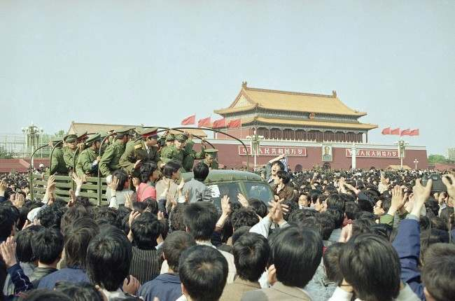 Chinese marchers are jubilant as they surround and stop an army truck at Tiananmen Square, April 27, 1989 in Beijing. (AP Photo/Mark Avery)