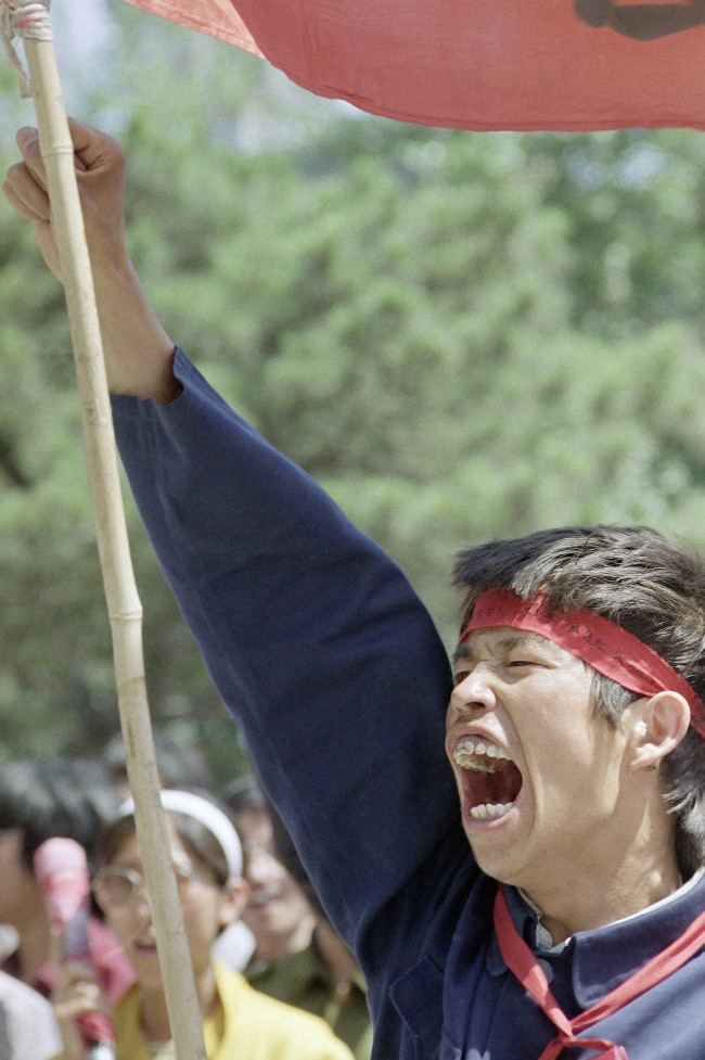 A Beijing University student sounds off during a rally, Thursday, May 25, 1989 in Beijing in Tiananmen Square. (AP Photo/Liu Heung Shing)