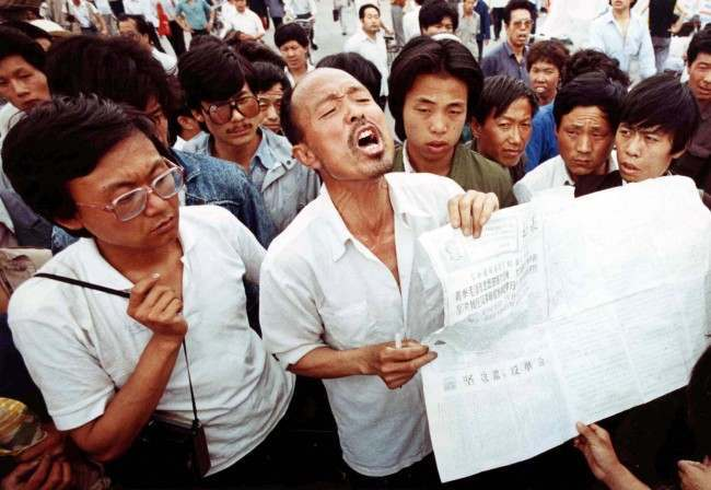 A man who identified himself as a former political prisoner relates his experiences to striking students in Tiananmen Square, Beijing, on May 28, 1989. Students have held the square in a democracy demonstration for more than two weeks. (AP Photo/Staff/Widener)