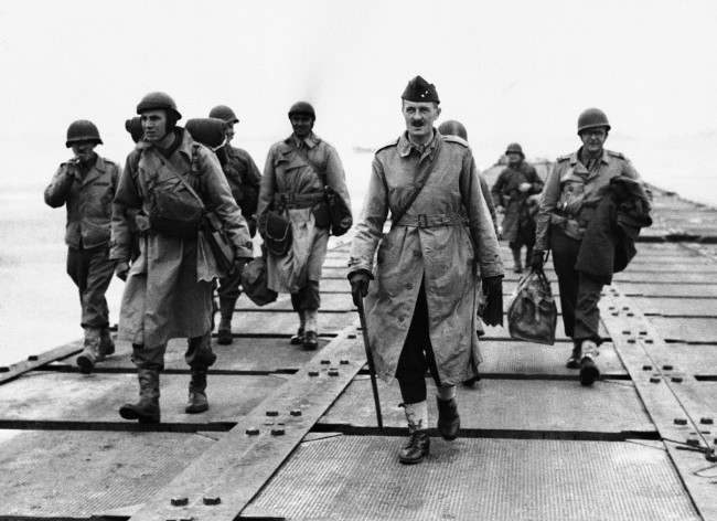 French General Philippe Le Clerc, carrying walking stick, shown walking down a pier somewhere in Normandy, France, on Aug. 2, 1944, after his arrival. This is his first visit to France in four years. (AP Photo)