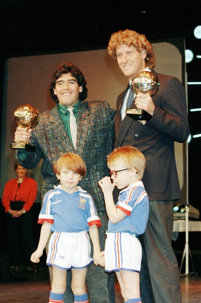 Argentina's soccer star Diego Maradona, left, and West German goalkeeper Harald Schumacher