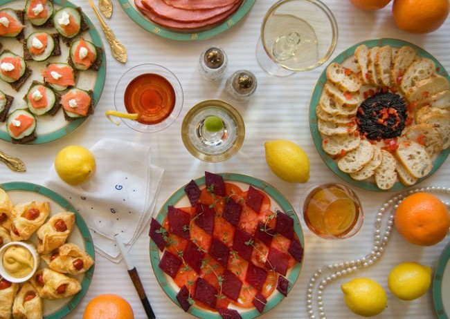 The Great Gatsby by F. Scott Fitzgerald, 1925 'On buffet tables, garnished with glistening hors-d'oeuvre, spiced baked hams crowded against salads of harlequin designs and pastry pigs and turkeys bewitched to a dark gold.'