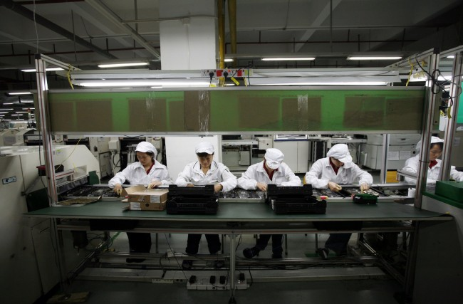 Workers are seen inside a Foxconn factory in the township of Longhua in the southern Guangdong province May 26, 2010. A spate of nine employee deaths at global contract electronics manufacturer Foxconn, Apple's main supplier of iPhones, has cast a spotlight on some of the harsher aspects of blue-collar life on the Chinese factory floor.