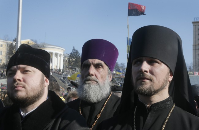 Ukrainian orthodox priests attend a pro-Ukrainian rally in the Independence Square in Kiev, Ukraine, Sunday March 9, 2014. Russian former oil tycoon Mikhail Khodorkovsky addressed a crowd on the square where demonstrators rose up against Ukraine's Moscow-backed president and said on Sunday Russia had been complicit in police violence against the protesters. (AP Photo/Efrem Lukatsky)