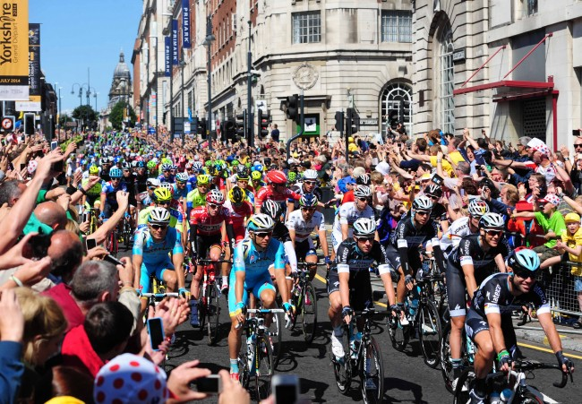 Mark Cavendish (front) lead the Grand Depart at the ceremonial start of The Tour De France 2014.