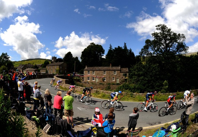 The Peloton passes through the village of Reeth, Yorkshire during the 2014 Tour de France.