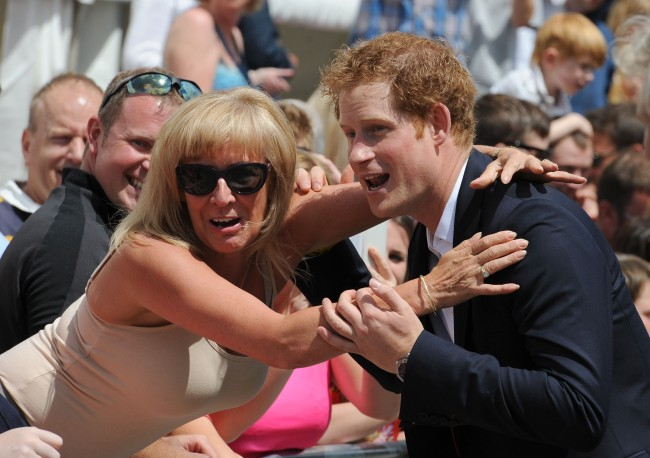 Prince Harry meets a member of the crowd during a visit to West Tanfield, North Yorkshire for start of the Tour de France.