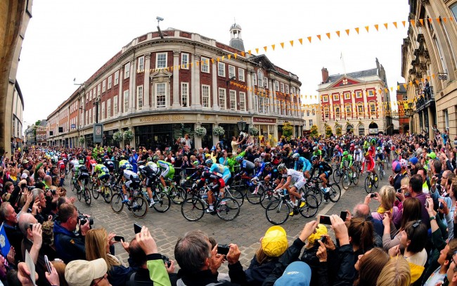 The 2014 Tour De France navigates it's way through York passing Bettys Tea Rooms and the Mansion House.