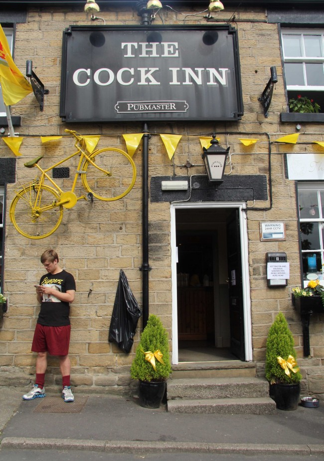 A man waits outside the Cock Inn in Oughtibridge, Sheffield, for the 2014 Tour de France to arrive.