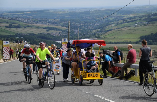 ans make their way to the summit as stage two of the Tour de France passes over Holme Moss Moor, Yorkshire.