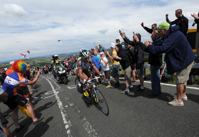 AG2R La Mondiale's Blel Kadri leads the peloton as stage two of the Tour de France passes over Holme Moss Moor, Yorkshire.