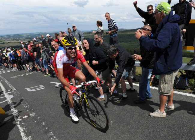 onfidis rider Nicolas Edet makes his way to the summit ahead of the main peloton as stage two of the Tour de France passes over Holme Moss Moor, Yorkshire.