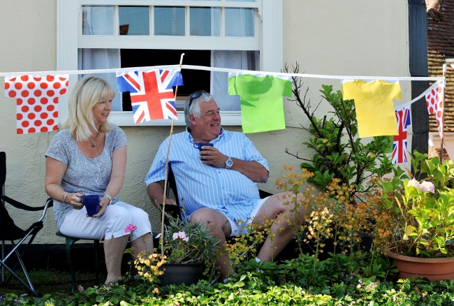 Clive and Andrea Bush sit outside their house in the village of Finchingfield in north Essex