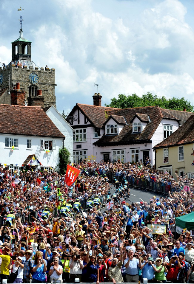 Team SKY riders make their way up the short climb in the village of Finchingfield in north Essex during stage three of the Tour de France from Cambridge to London.