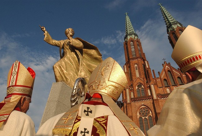 Priests celebrate a mass in honor of the Rev. Ignacy Jan Skorupka, who rallied Polish troops to victory over Russian Bolsheviks in 1920, during ceremonies of unveiling Skorupka's monument in Warsaw, Poland, on Saturday, Aug. 13, 2005. (AP Photo/Czarek Sokolowski)