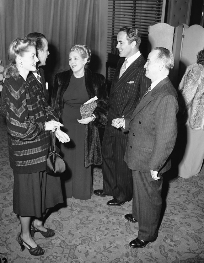 Left to right are actress Lauren Bacall, Humphrey Bogart, Mary Pickford, Buddy Rogers, and Raymond McCall of the New York Times, at Associated Press managing editors dinner at Los Angeles Biltmore Bowl on Nov. 29, 1946.