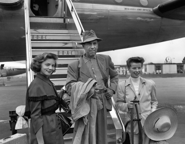 Actor Humphrey Bogart, his actress wife Lauren Bacall (L) and actress Katharine Hepburn at London Airport, after arriving in the UK from Africa after filming. 1951