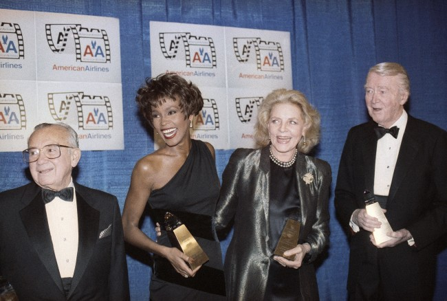 From left, Columbia Pictures chairman Leo Jaffe, Whitney Houston, Lauren Bacall and Jimmy Stewart receive awards at the Eighth American Cinema Awards in Beverly Hills, Calif., Jan. 12, 1991. The American Cinema Foundation supplies educational scholarships in theater arts, music and dance. (AP Photo/Craig Fujii)