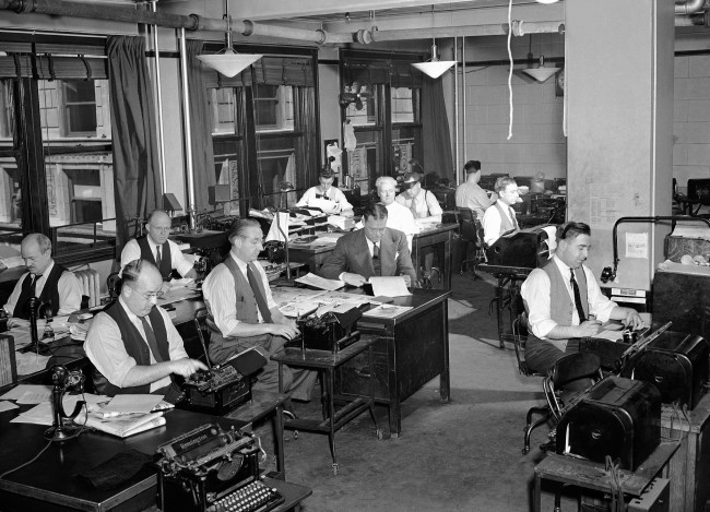 The increase of the New England area in importance as an arsenal and defense sector has greatly increased the importance of news gathered and edited by the staff of the New England bureau of the Associated Press. Rapid expediting of quick-breaking war developments throughout the world also keeps the staff busy, shown May 7, 1942. (AP Photo) Ref #: PA.11540843  Date: 07/05/1942