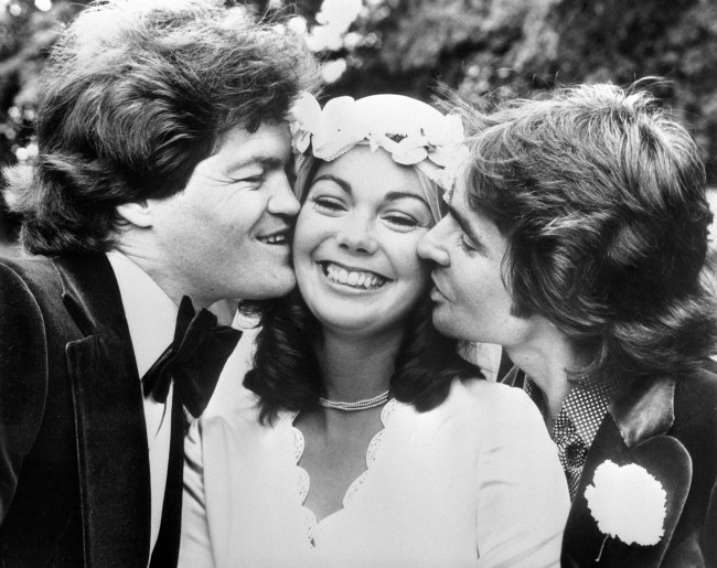 Davy Jones, right, getting in on the act when Micky Dolenz married 23 year old Trina Dow of Saffron Walden at the tiny church of St Mary's Virgin at Little Sampford. Davy and Micky found fame as members of the American pop group The Monkees. Date: 18/06/1977