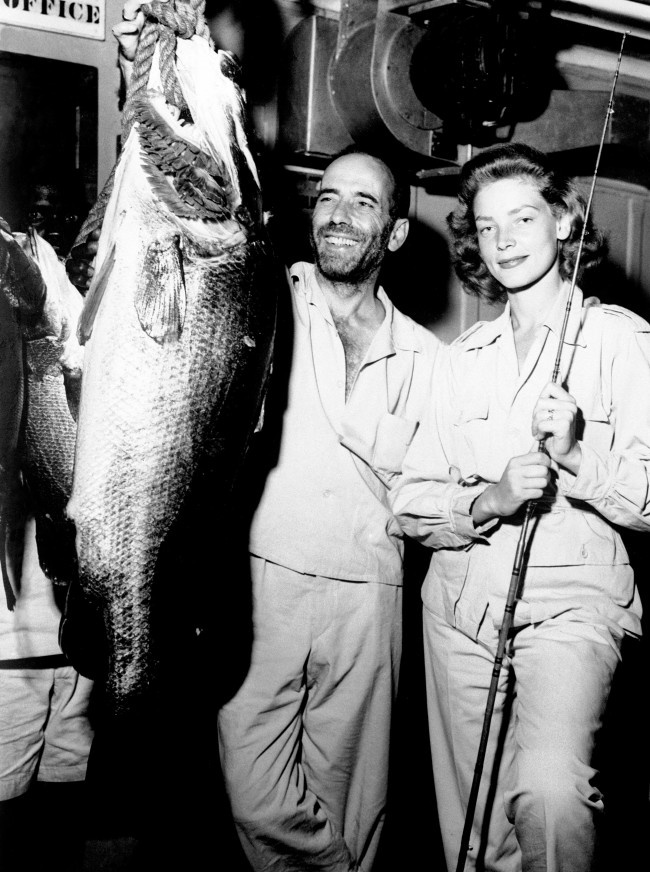American actor Humphrey Bogart and his actress wife Lauren Bacall with a Nile Perch, which he caught while on location in Africa for exterior scenes in his new film 'The African Queen'. Date: 01/09/1951