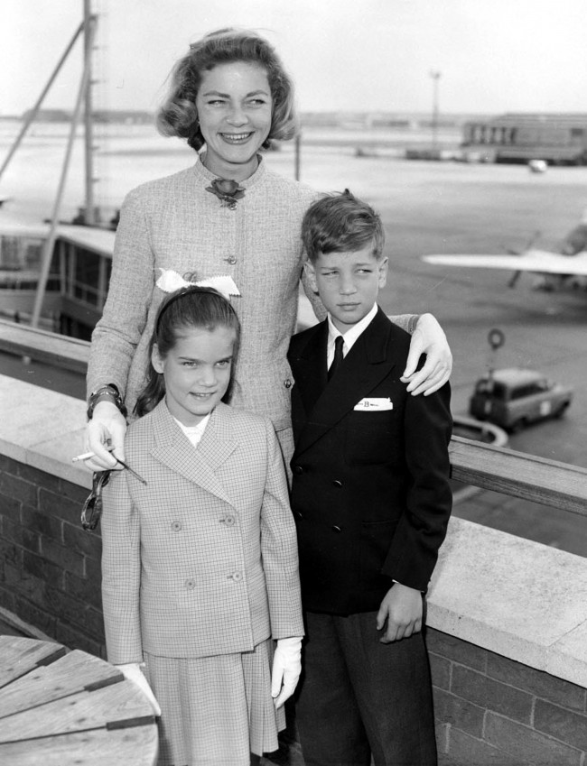 American actress Lauren Bacall with her two children Leslie and Stephen as they left London Airport for a five week holiday in Biarritz. Date: 14/07/1959