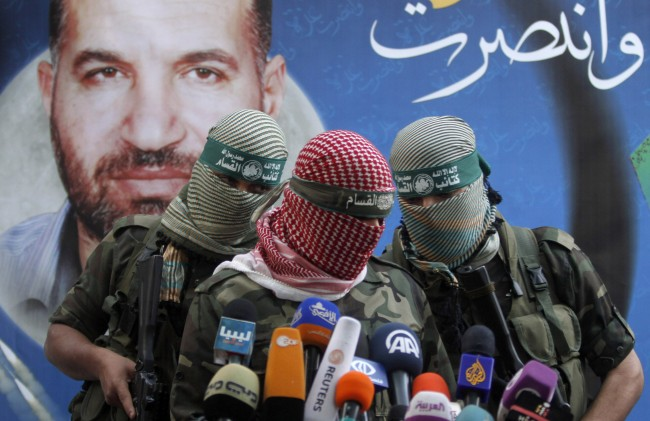 A Hamas militant talks during a press conference in Gaza City, Thursday, Nov. 22, 2012.