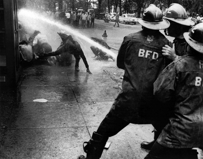 FILE - In this July 15, 1963 file photo, firefighters use their water hose against civil rights demonstrators in Birmingham, Ala. (AP Photo/Bill Hudson, File) Ref #: PA.17396563  Date: 15/07/1963