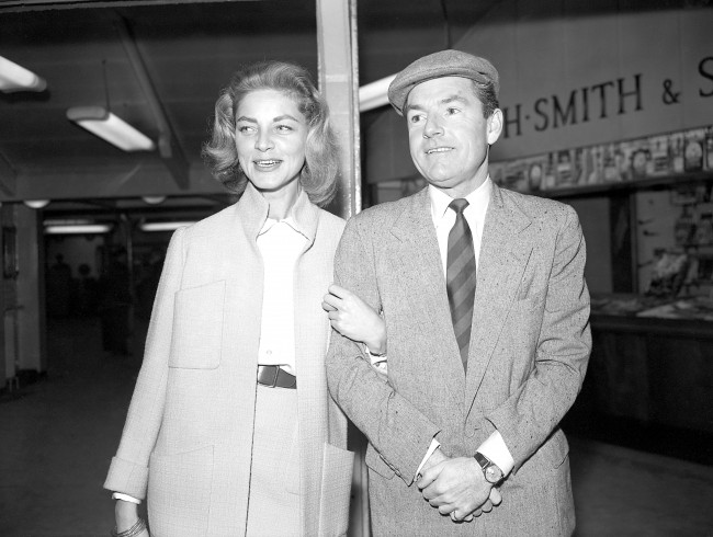 American actress Lauren Bacall and British actor Kenneth More at London Airport. They were flying to India to shoot scenes for their film North West Frontier. Date: 29/03/1959