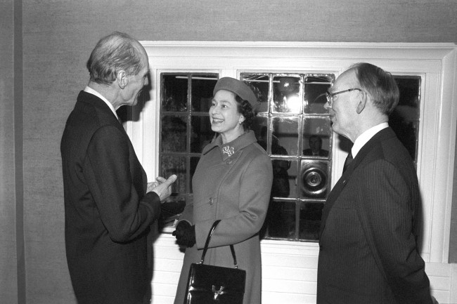 The Queen, talking to Group captain Leonard Cheshire, VC, at the Arnold House Cheshire Home in Enfield, when she opened a new wing at the home for disabled people. Ref #: PA.18807766  Date: 09/02/1983