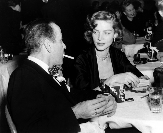 This Feb. 1950 file photo shows actor Humphrey Bogart, left, and his wife actress Lauren Bacall appear at the Stork Club in New York. Bacall, the sultry-voiced actress and Humphrey Bogart's partner off and on the screen